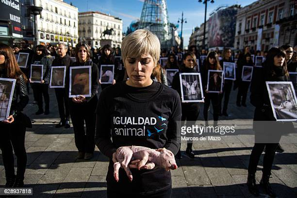 Woman posing with a dead pig during the International Animal Rights Day.