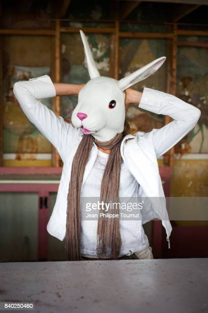woman posing with a rabbit mask - rabbit mask stock pictures, royalty-free photos & images