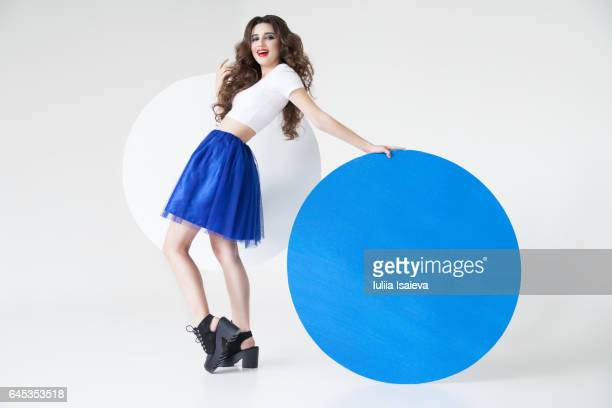 Woman posing with blue circle