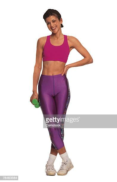 Woman posing with dumbbells