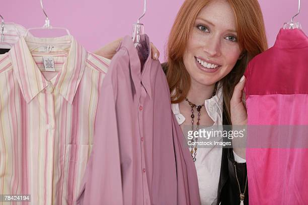 Woman posing with pink blouses