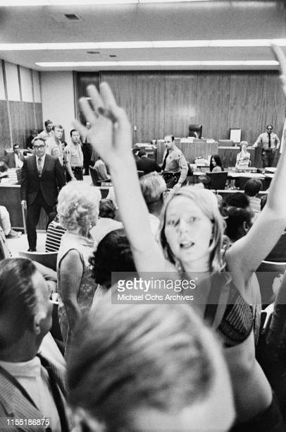 Woman, possibly member of the Manson Family Catherine Gillies , tries to catch the attention of reporters during a hearing regarding the murder of...