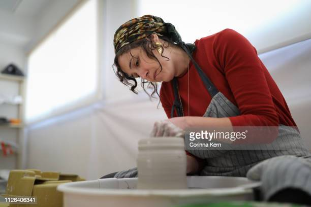 woman pottery artist working on pottery wheel - jewish people stock pictures, royalty-free photos & images