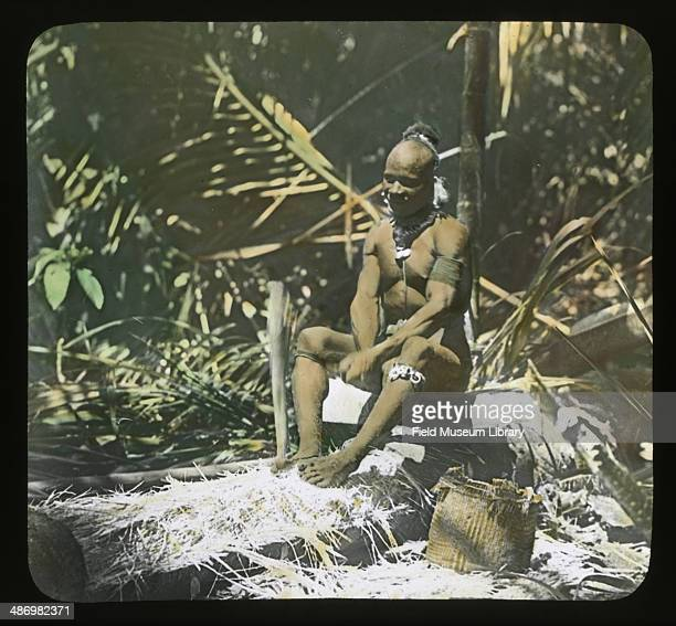 A woman pounding out the pith during the pottery making process Papua New Guinea May 20 1910