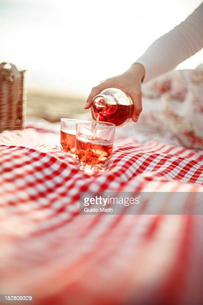 Woman pouring glasses rose