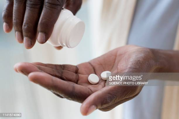 woman pouring pills - taking a pill stock pictures, royalty-free photos & images