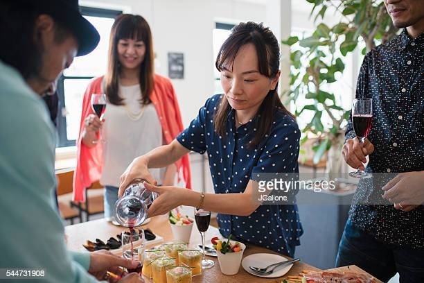 Woman pouring wine into a friends glass
