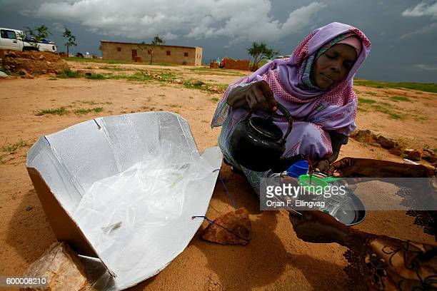 A woman pours tea boiled in the solar oven in the Iridimi refugee camp 8600 families in this refugee camp now use the solar oven manufactured on site...