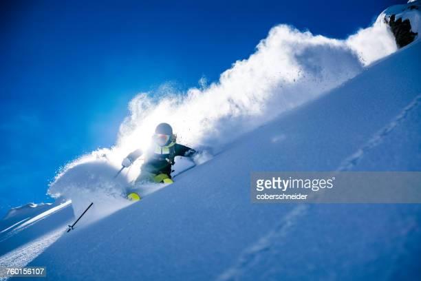 Woman powder skiing, Gastein, Salzburg, Austria