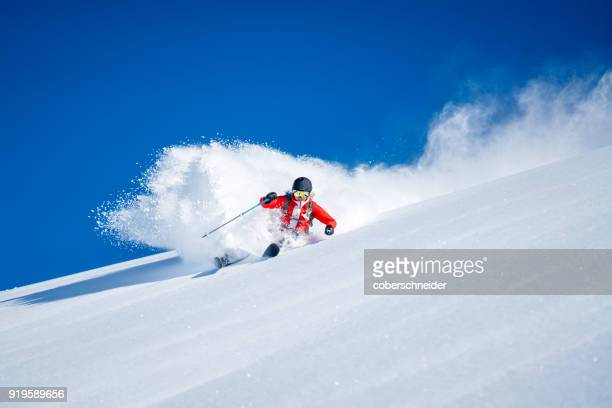 Woman Powder Skiing in the Alps, Sportgastein, Salzburg, Austria