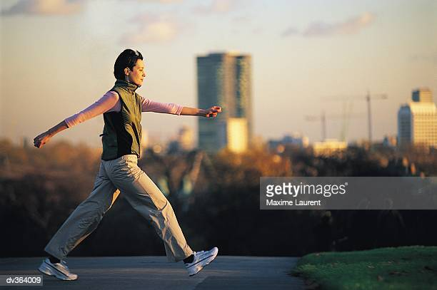 woman power walking - striding stock pictures, royalty-free photos & images