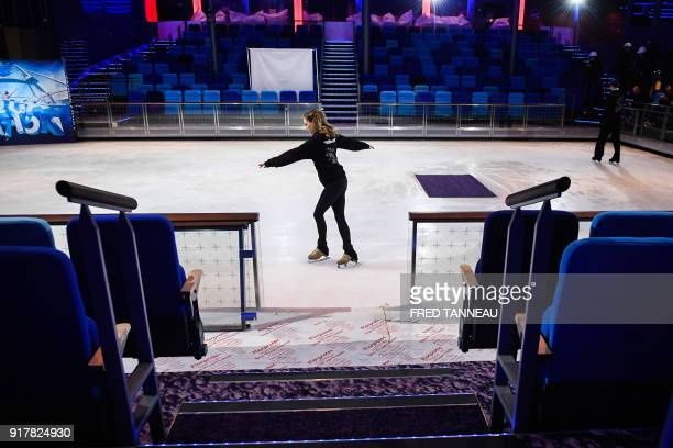 A woman practices on an ice rink inside US shipowner Royal Caribbeans new Oasisclass cruise ship Symphony of the Seas the largest passenger ship ever...