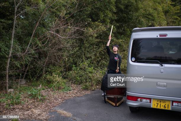 A woman practices the traditional Japanese Taiko drum in a carpark in Akigase Park on March 24 2018 in Tokyo Japan In densely populated Tokyo where...
