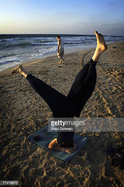 A woman practices yoga during a moment of quiet July 16 2005 at the beach settlement of Shirat Hyam Gaza Strip Many people have come into the Gush...