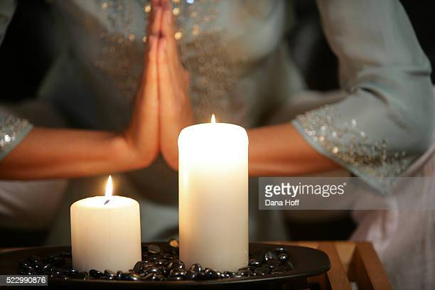 woman practices yoga in a residential meditation studio - spirituality stockfoto's en -beelden