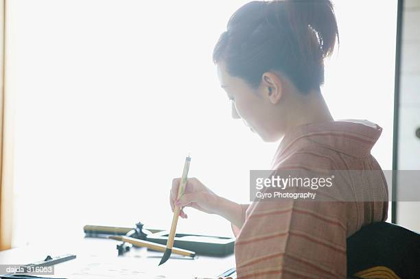 Woman practicing a shodo