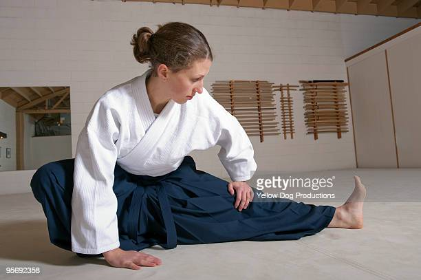 Woman practicing aikido martial arts