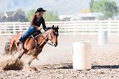 https://www.istockphoto.com/photo/woman-practicing-barrel-racing-in-arena-on-ranch-moving-at-speed-dust-flying-gm992633922-268924832