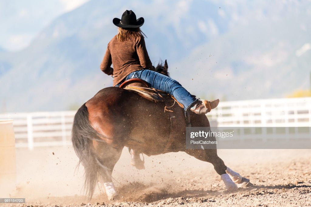 Woman Practicing Barrel Racing In Arena On Ranch Ranch High Res Stock Photo Getty Images
