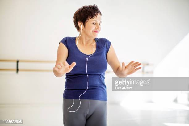 woman practicing fitness dance with music - fat lady in leggings stock photos and pictures
