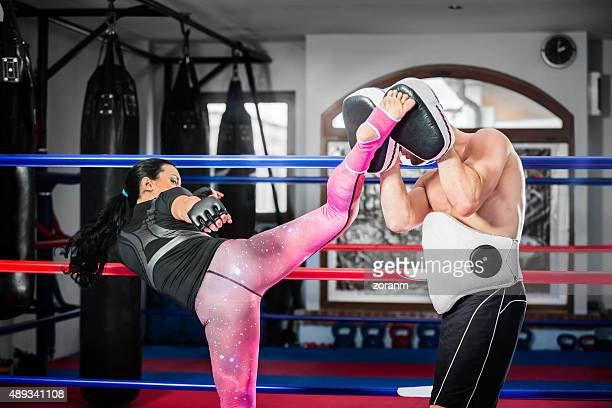 woman practicing kickbox - muay thai stock pictures, royalty-free photos & images
