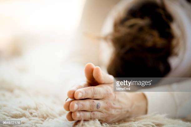 woman practicing kundalini yoga and sun salutation - ceremony stock pictures, royalty-free photos & images