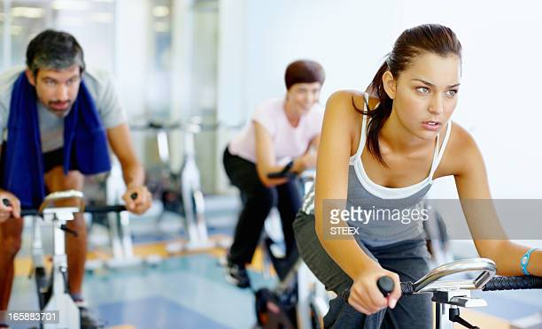 Woman practicing on spinning bike at gym