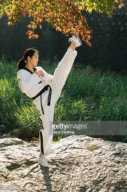 Woman Practicing Tae Kwon Do