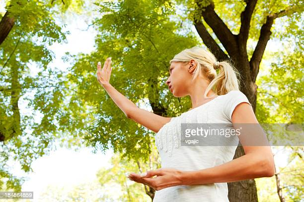 Woman Practicing Tai Chi Outdoor