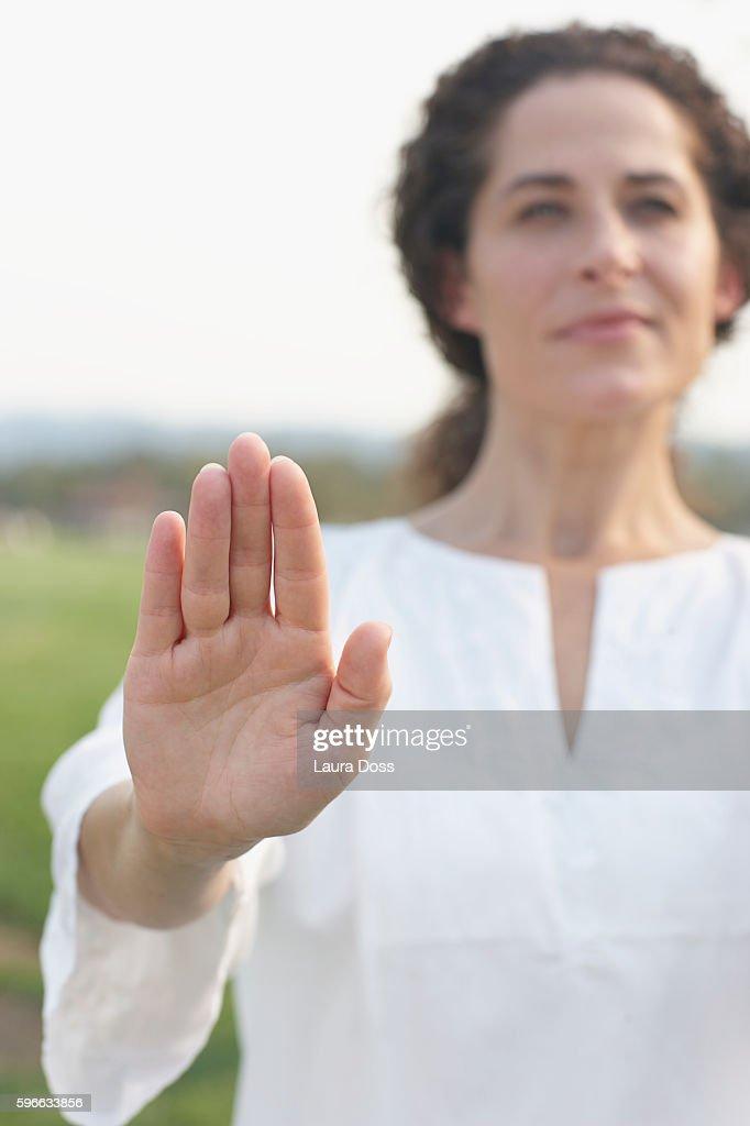 Woman practicing tai chi : Stock Photo
