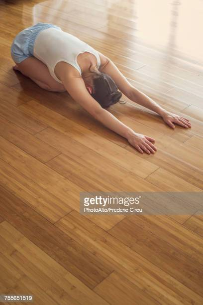 woman practicing yoga childs post - childs pose stock photos and pictures