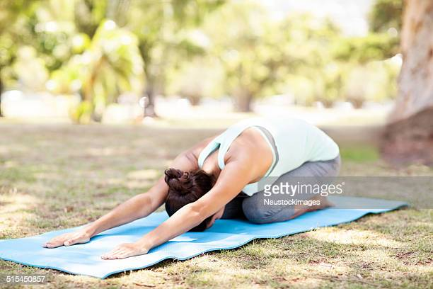 woman practicing yoga in childs pose - childs pose stock photos and pictures