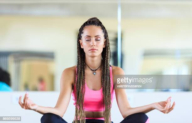 woman practicing yoga in gym - yoga teacher stock pictures, royalty-free photos & images