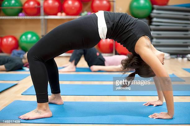 Woman practicing yoga in studio