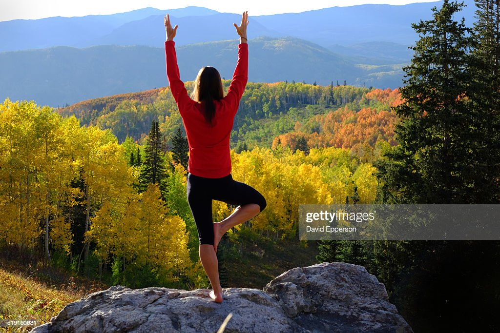 Woman practicing yoga outdoors in fall colors : Stock Photo