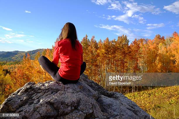 woman practicing yoga outdoors in fall colors - steamboat springs colorado stock photos and pictures