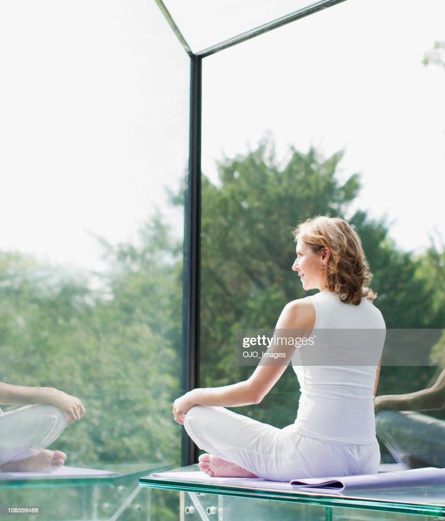 Woman practicing yoga : Stock Photo