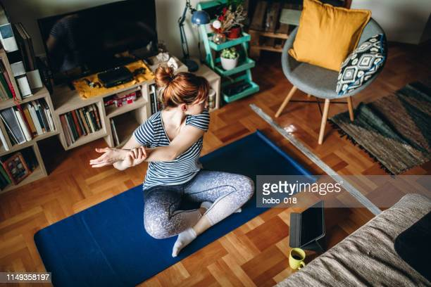 woman practicing yoga - exercising stock pictures, royalty-free photos & images
