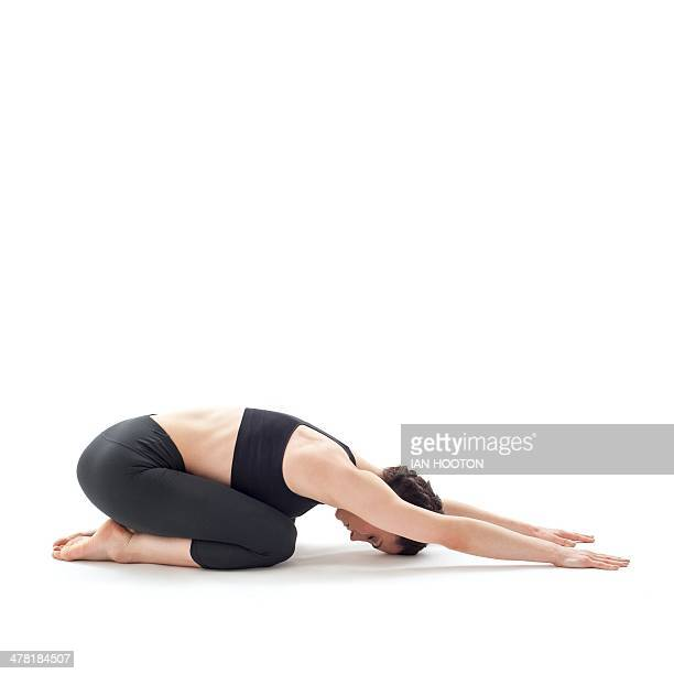woman practicing yoga - childs pose stock photos and pictures