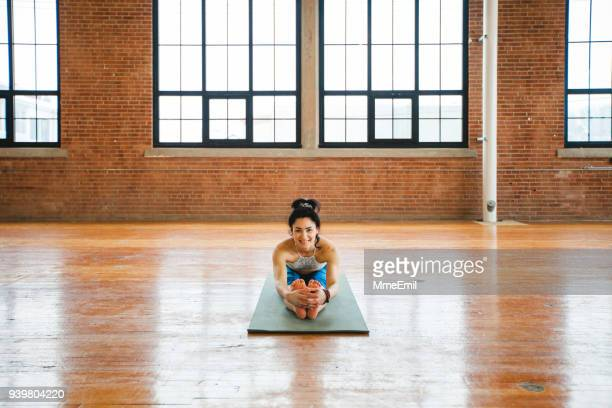 Woman practicing yoga. Seated Forward Bend pose. Paschimottanasana