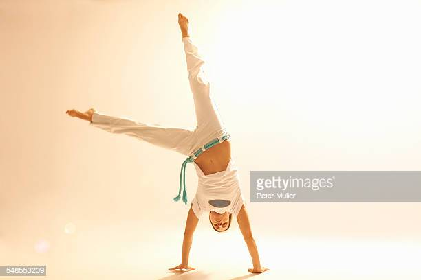woman practising capoeira - cartwheel stock pictures, royalty-free photos & images