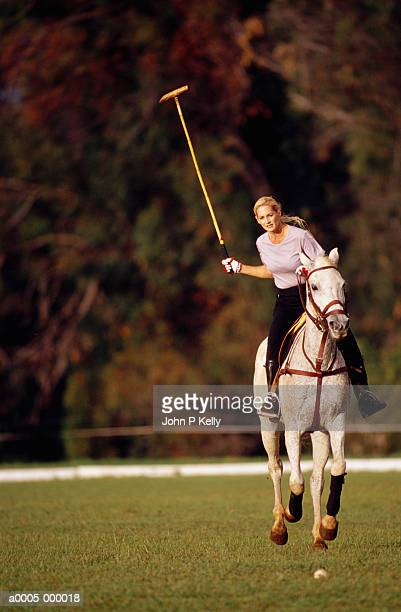 woman practising polo - polo stock pictures, royalty-free photos & images