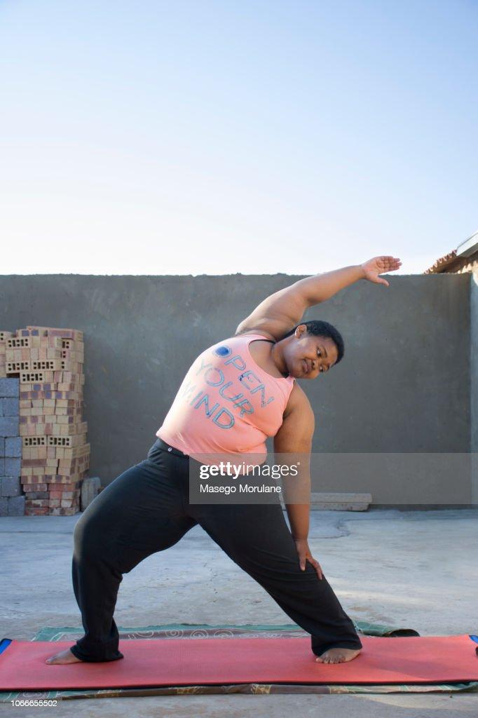 Woman practising yoga : Stock Photo