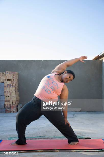woman practising yoga - showus stock pictures, royalty-free photos & images