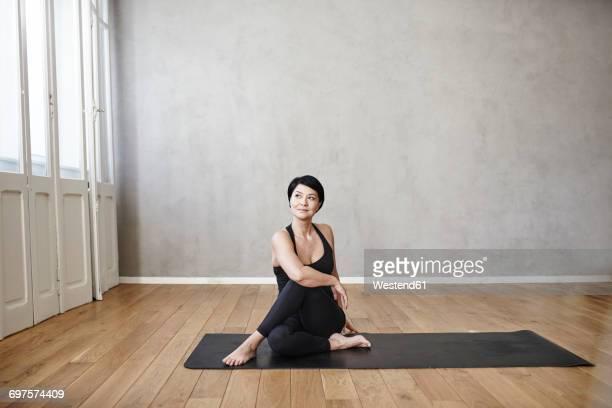 woman practising yoga - yoga studio stock pictures, royalty-free photos & images