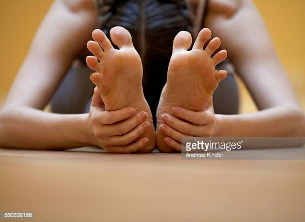 a woman practising yoga skane sweden - soles pose stock photos and pictures