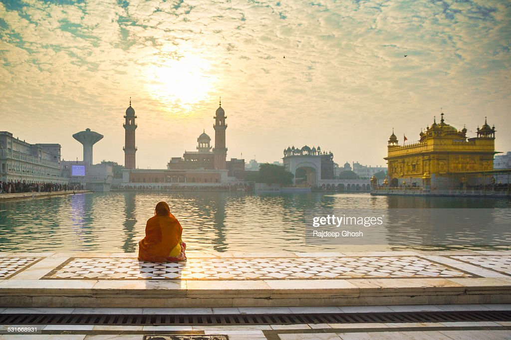 Woman pray at Golden temple : Stock Photo