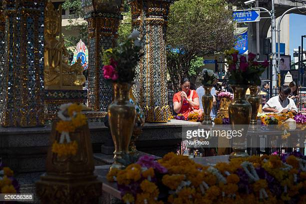 Woman pray at the reopened Erawan Shrine in Central Bangkok on August 19th 2015, after a bomb exploded outside this shrine on August 17th, 2015. The...
