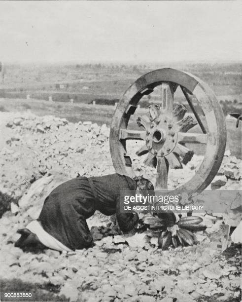 Woman praying at her son's grave in the World War I memorial and cemetery of Redipuglia FriuliVenezia Giulia Italy from L'Illustrazione Italiana Year...