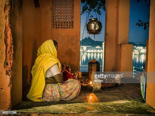 Woman praying at night in Pushkar